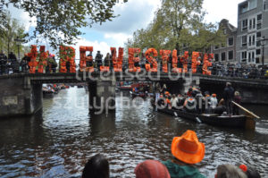 """#re.vestlife"" hash tag sign on an Amsterdam canal bridge - Adam Szuly Photography"