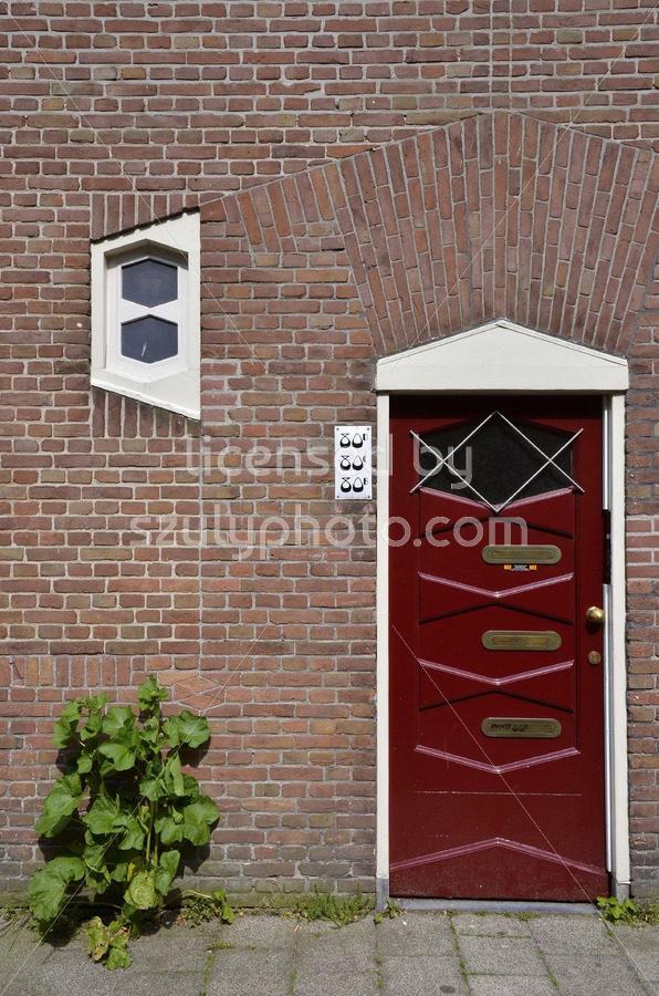 Red entrance door of the Spaardammercarre - Adam Szuly Photography