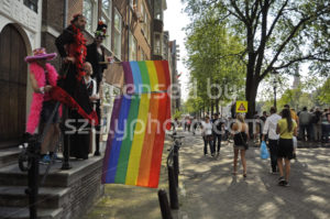 Side view of four men with rainbow flags - Adam Szuly Photography