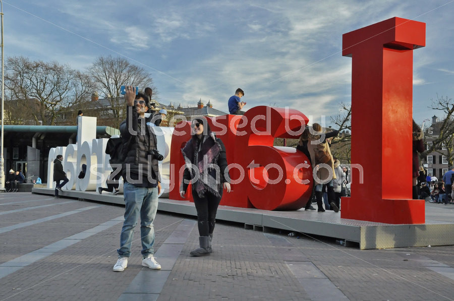 Tourists taking a selfie at the Iamsterdam sign - Adam Szuly Photography