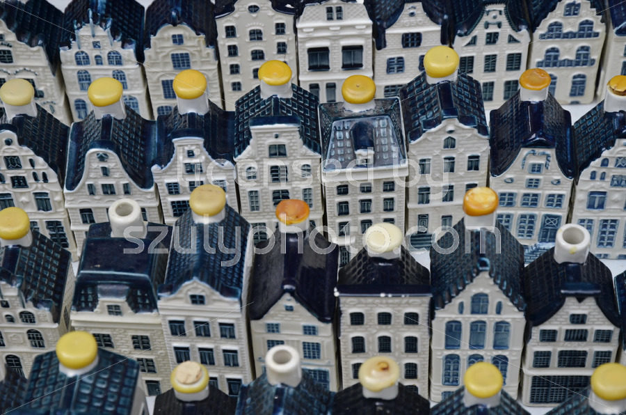 White KLM pottery canal houses on the Noordermarkt - Adam Szuly Photography