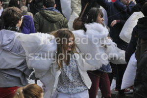 Young woman and torn pillow at the pillow fight - Adam Szuly Photography