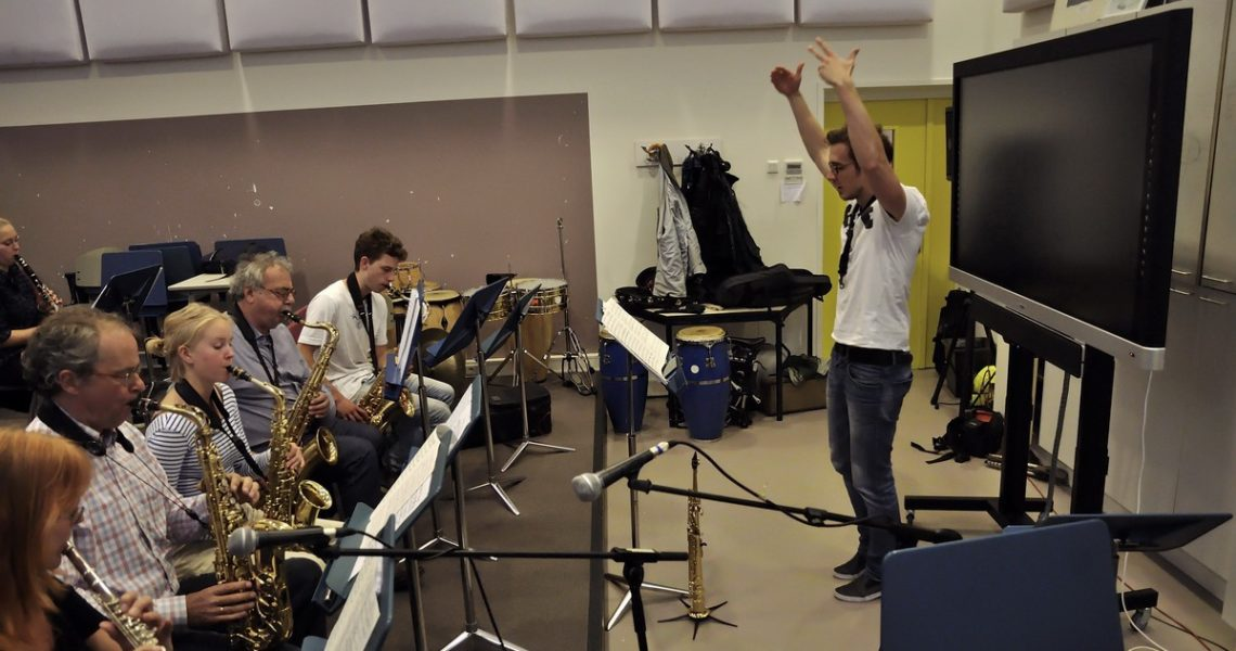 "Coaching a jazz band in the Music School. The Dutch are good students he says, eager to learn and very community oriented. ""Something we Hungarians really need to learn from them."""