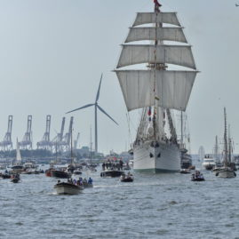 Ij River, Amsterdam, the Netherlands - August 19, 2015: Long distance frontal view of the Esmeralda tall ship (Chile) among small spectator boats on the Ij river, approaching the port of Amsterdam on the 1st day of the SAIL 2015 (www.sail.nl), an international public nautical event held once in every 5 years since 1975.