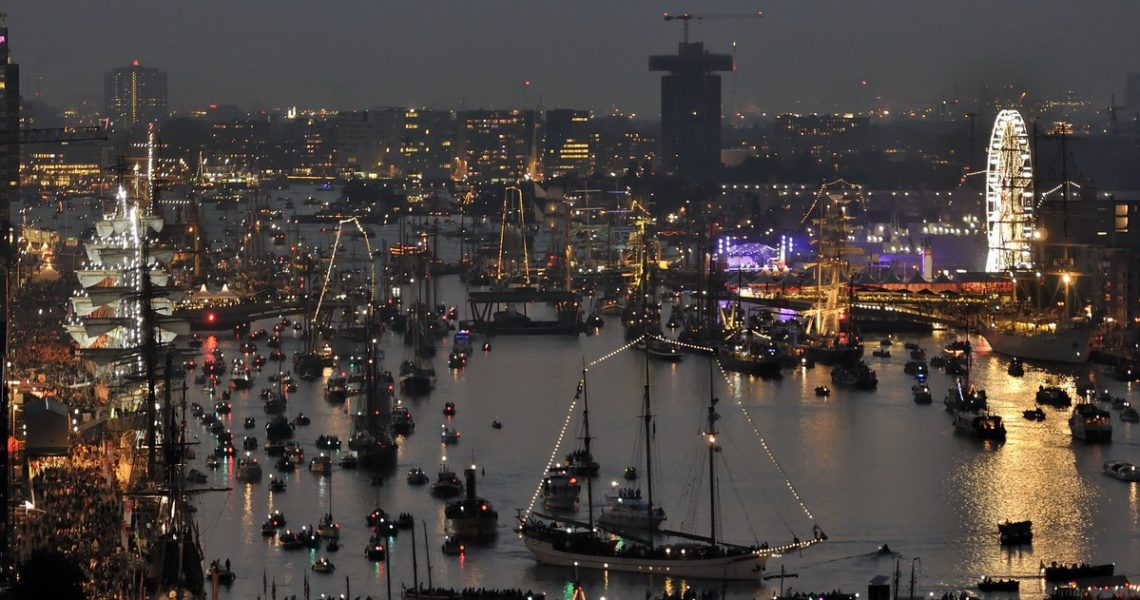 Amsterdam, the Netherlands - August 19, 2015: Evening view of the Ijhaven port at the time of the SAIL 2015 (www.sail.nl), an international public nautical event held once in every 5 years since 1975.