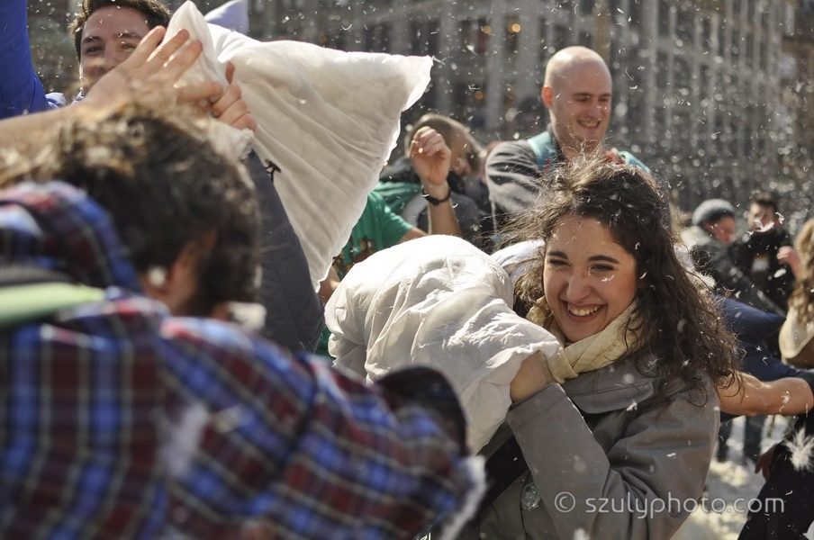 Amsterdam, Netherlands: A young woman and a man playing at the time of the Pillow Fight Day, an international public outdoor event held every year in different cities around the globe