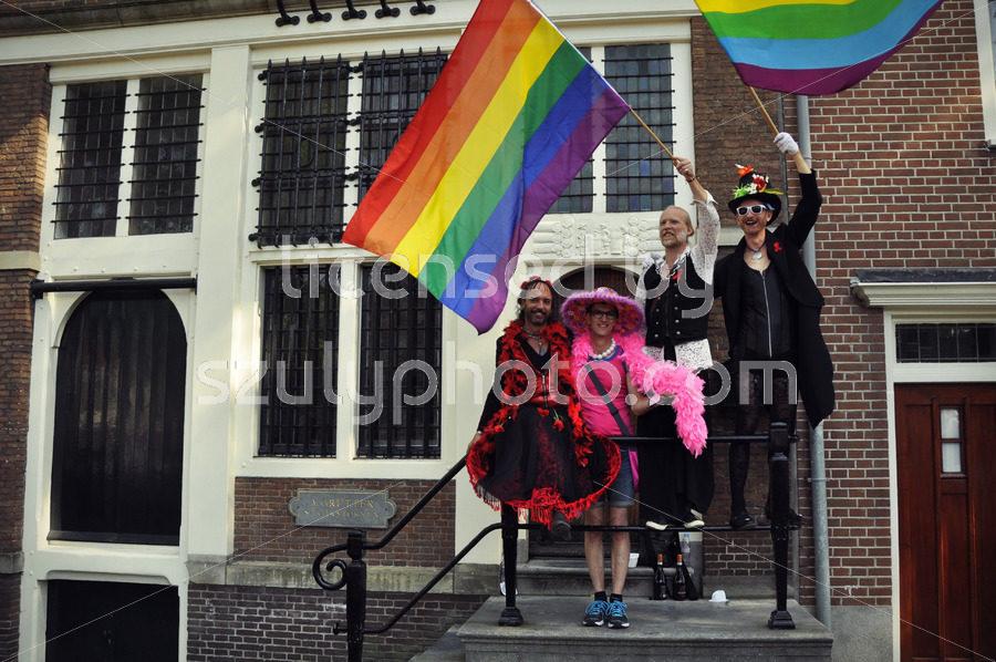 Four men with rainbow flags - Adam Szuly Photography