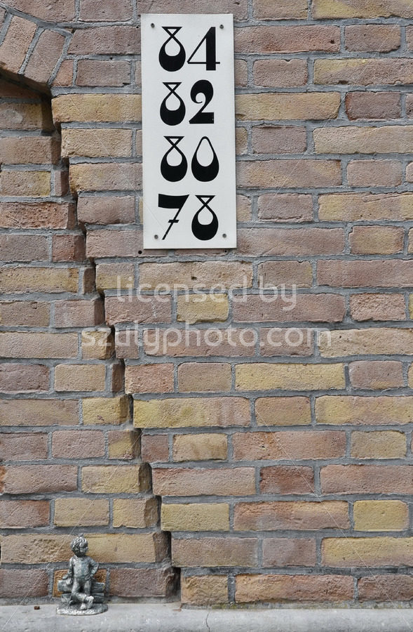House numbers on a brick wall - Adam Szuly Photography