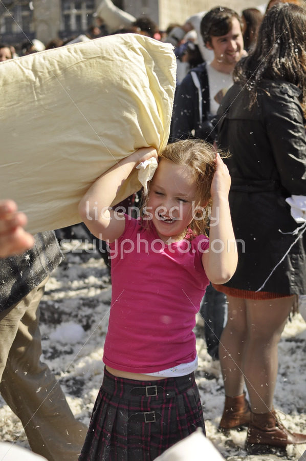 Kid having fun on Pillow fight day in Amsterdam - Adam Szuly Photography