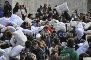 Pillow fight in front of the Dam Square Monument - Adam Szuly Photography