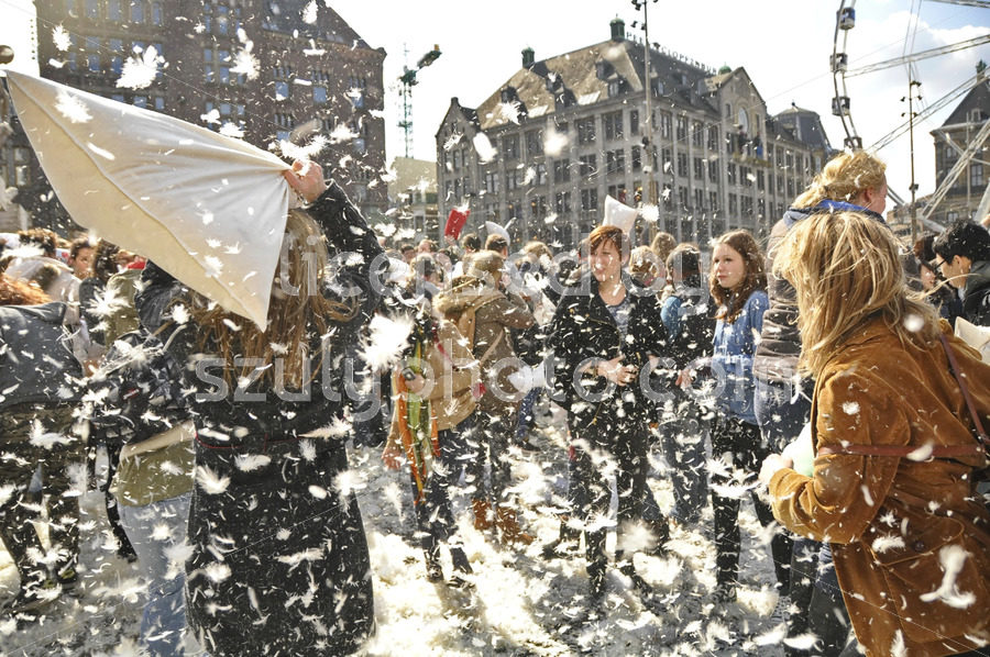Snowing feathers on pillow fight day Amsterdam - Adam Szuly Photography
