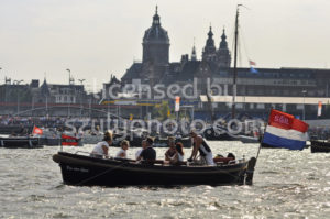 Spectators in a passenger boat - Adam Szuly Photography