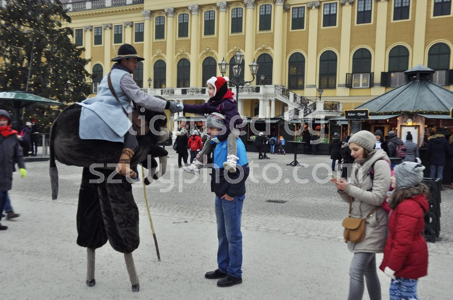 Stilt walker and visitor - Adam Szuly Photography