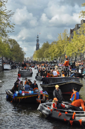 The Prinsengracht with the Westerkerk at the time of King's Day - Adam Szuly Photography