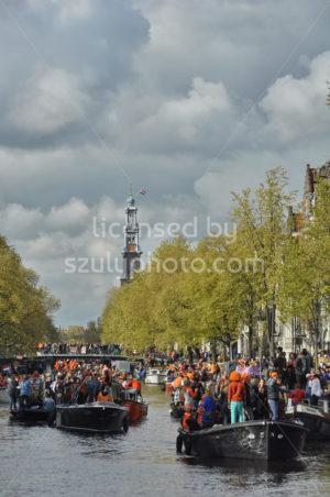The Prinsengracht with the Westerkerk in the background at the time of King's Day - Adam Szuly Photography