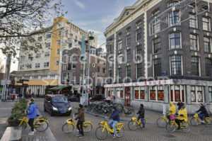 Tourists on bicycles on the Nieuwmarkt - Adam Szuly Photography