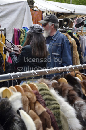 Two visitors on the flee market at a clothing rack - Adam Szuly Photography